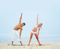 Young couple working out at the beach together Royalty Free Stock Photo