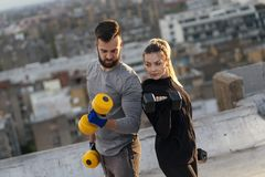 Couple doing arms exercises royalty free stock photography