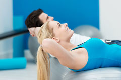 Young couple working out in a gym Royalty Free Stock Photography