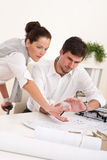 Young couple working together Royalty Free Stock Image