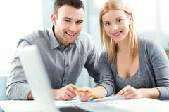 Young couple working together Stock Images