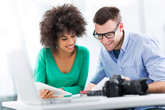 Young couple working together. Business people meeting at table royalty free stock photos