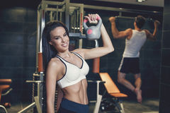 Young couple workout in gym Stock Images