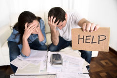 Young couple worried at home in bad financial situation stress asking for help. Young couple worried need help in stress at home couch accounting debt bills bank