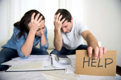 Young couple worried at home in bad financial situation stress asking for help. Young couple worried need help in stress at home couch accounting debt bills bank Royalty Free Stock Photos