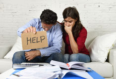 Young couple worried at home in bad financial situation stress asking for help Royalty Free Stock Photo