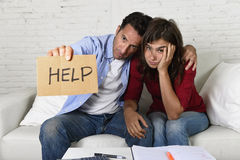 Young couple worried at home in bad financial situation stress asking for help Stock Photos
