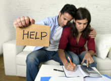 Young couple worried at home in bad financial situation stress asking for help. Young couple worried need help in stress at home couch accounting debt bills bank Stock Image