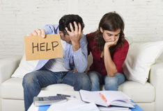 Young couple worried at home in bad financial situation stress asking for help. Young couple worried need help in stress at home couch accounting debt bills bank Royalty Free Stock Image