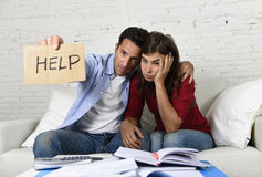 Young couple worried at home in bad financial situation stress asking for help Royalty Free Stock Photography