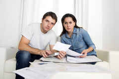 Young couple worried at home in stress accounting bank payments Royalty Free Stock Photo