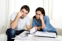 Young couple worried at home in stress accounting bank payments Royalty Free Stock Photos