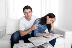 Young couple worried home in stress husband comforting wife in financial problems Stock Photo