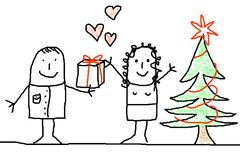 Young couple with xmas tree Royalty Free Stock Image