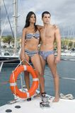 Young couple in a yacht stock images