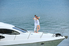 Young couple on yacht Royalty Free Stock Image