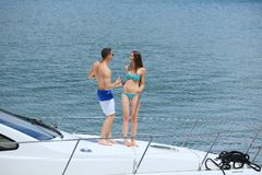 Young couple on yacht Stock Photos