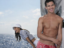 Young Couple On Yacht At Sea. Happy shirtless young men with women screaming on yacht Stock Photos