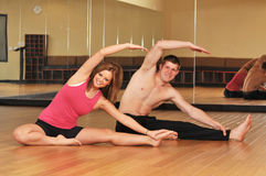 Young couple during a yoga session stock photography