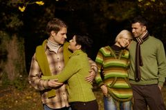 Young couples in autumn park Royalty Free Stock Photo