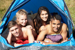 Young Couples On Camping Trip In Countryside Stock Image