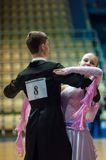 Young couples compete in sports dancing Stock Photos