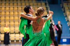 Young couples compete in sports dancing Stock Images