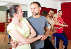 Young couples dancing Latino dance Royalty Free Stock Photo