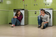 Young Couples Doing Housework Laundry Stock Images