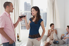 Young Couples Drinking Wine In Living Room Royalty Free Stock Photos