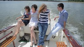 Young couples enjoying on the yacht stock footage