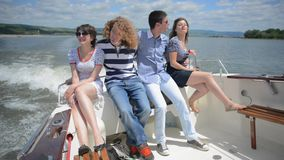 Young couples enjoying on the yacht stock video footage