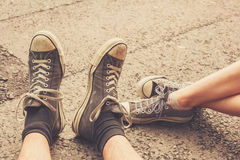 Young couples feet in the street Royalty Free Stock Photos