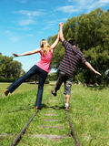 Young couples going along a railroad line. Happy young couples going along a railroad line Royalty Free Stock Image