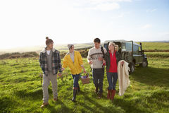 Young couples going for picnic in countryside Royalty Free Stock Photos