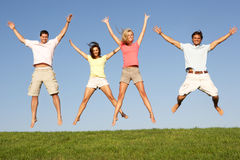 Young couples jumping in air Royalty Free Stock Images