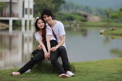 Young couples in the park. Young couples embracing in the park Royalty Free Stock Photography
