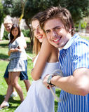 Young  couples playing tug of war game Royalty Free Stock Image
