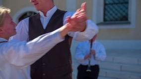 Young couples starts to dance for a new married couple stock footage