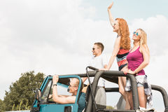Young couples travelling by car Stock Photography
