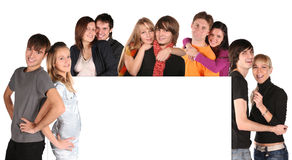 Young Couples With Board For Text Royalty Free Stock Photography