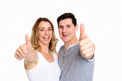 Young couplewith thumbs up Royalty Free Stock Photos