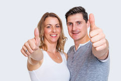 Young couplewith thumbs up Stock Images