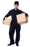 Young courier boy holding parcels Stock Image