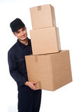 Young courier boy moving boxes Stock Images