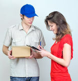 Young courier deliver package Royalty Free Stock Photography