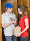 Young courier deliver package. To pretty woman Royalty Free Stock Images
