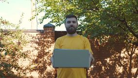 A young courier delivers the parcel stock video