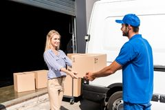 Courier giving package to woman Royalty Free Stock Photography