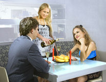 Young courting couple and waitress Royalty Free Stock Image